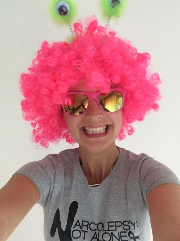 Claire is all smiles in the Netherlands! #narcolepsynotalone #pinkhair #yolo