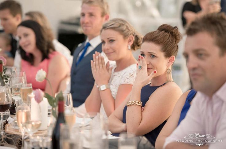 The guests react to a beautiful speech at the wedding reception. Check out other wedding photography by Anthony Turnham at www.snapweddingphotography.co.nz