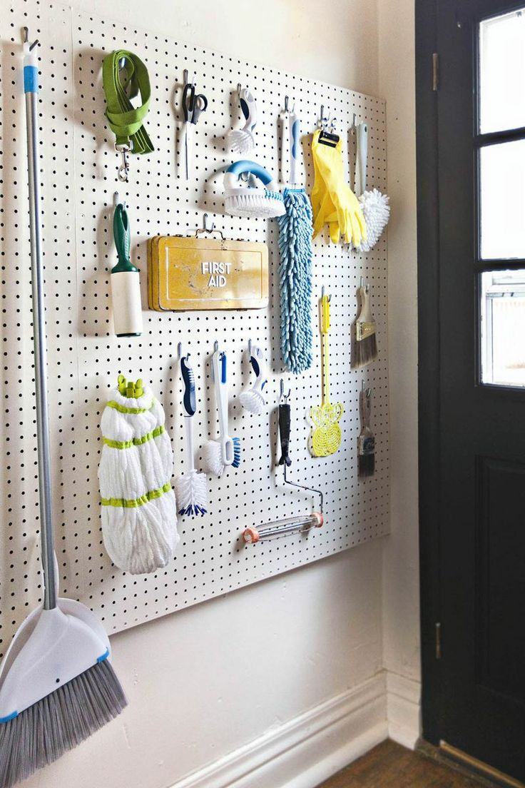 Use peg board to organize cleaning and laundry supplies