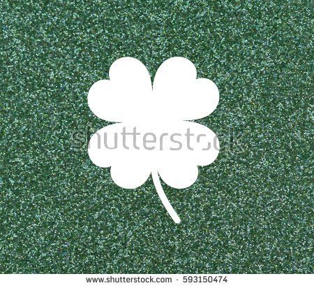 Clover with four leaves, White on a glittery green background.