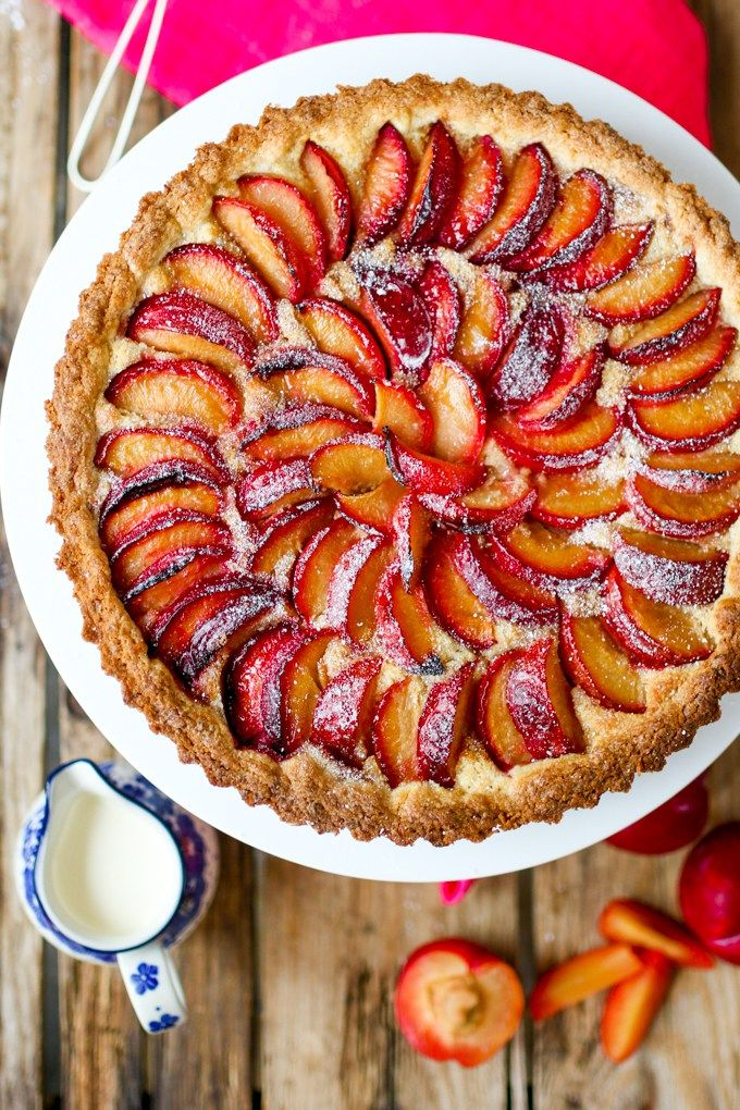 A fruit plum tart with almond frangipane and crumbly sweet pastry.