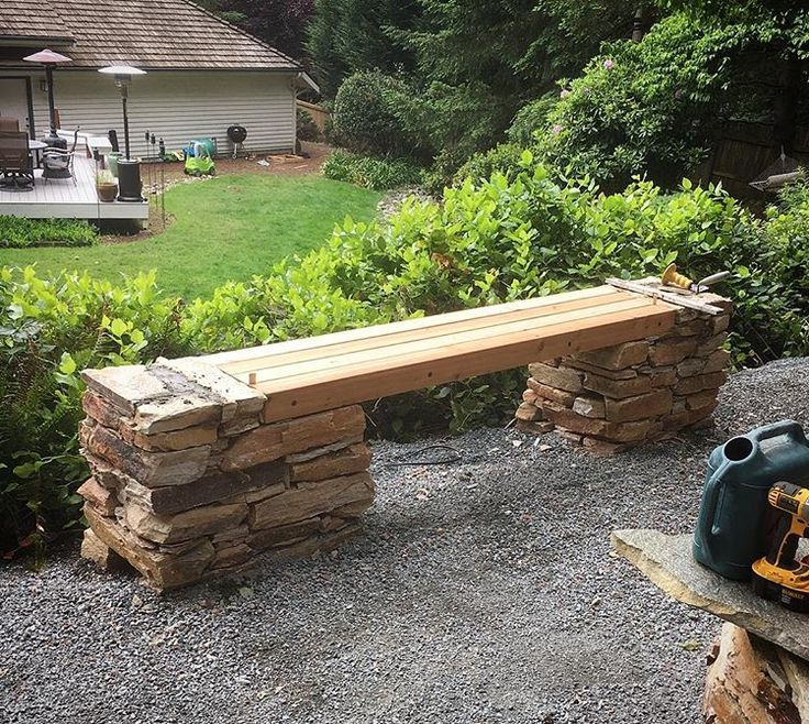Cedar bench built into these stone columns.  We used 4x4s, spaced and screwed with headlok fasteners, then finished with stone flush to each end to add some detail.  #design #landscape #landscaping #landscapedesign #hardscape #seattledesign #courtyard #pacificlivingconstruction #stone #outdoors #mason #masonry #seat #bench #working #garden #gardening #contractor #builder
