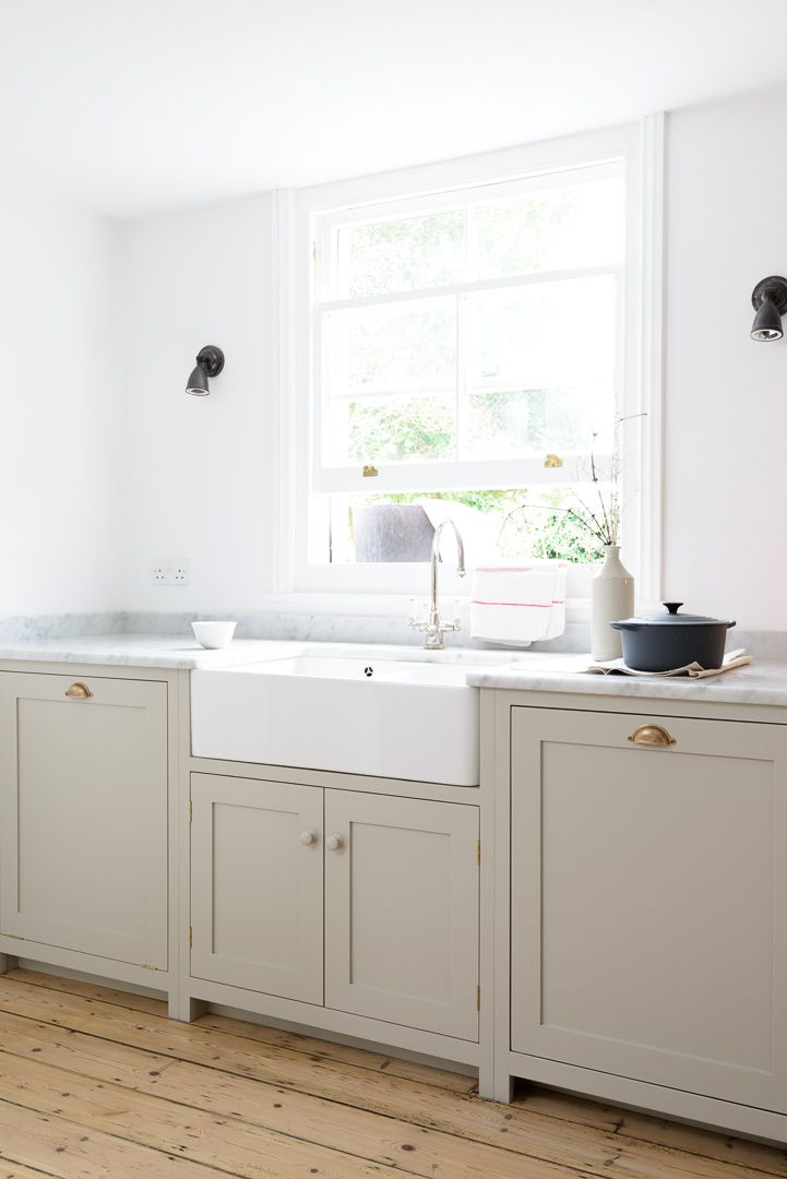 honed Carrara marble worktops, 'Mushroom' paint & lovely wooden floorboards are the perfect combination in deVOL's Brighton Kitchen