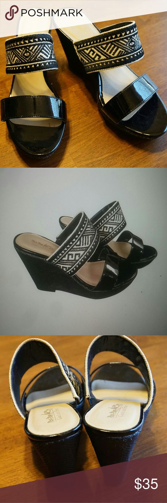 Coach woven tribal strap black and white wedges Super fun print and comfortable to wear. Wish they were my size, light wear on the sole. Coach Shoes Wedges