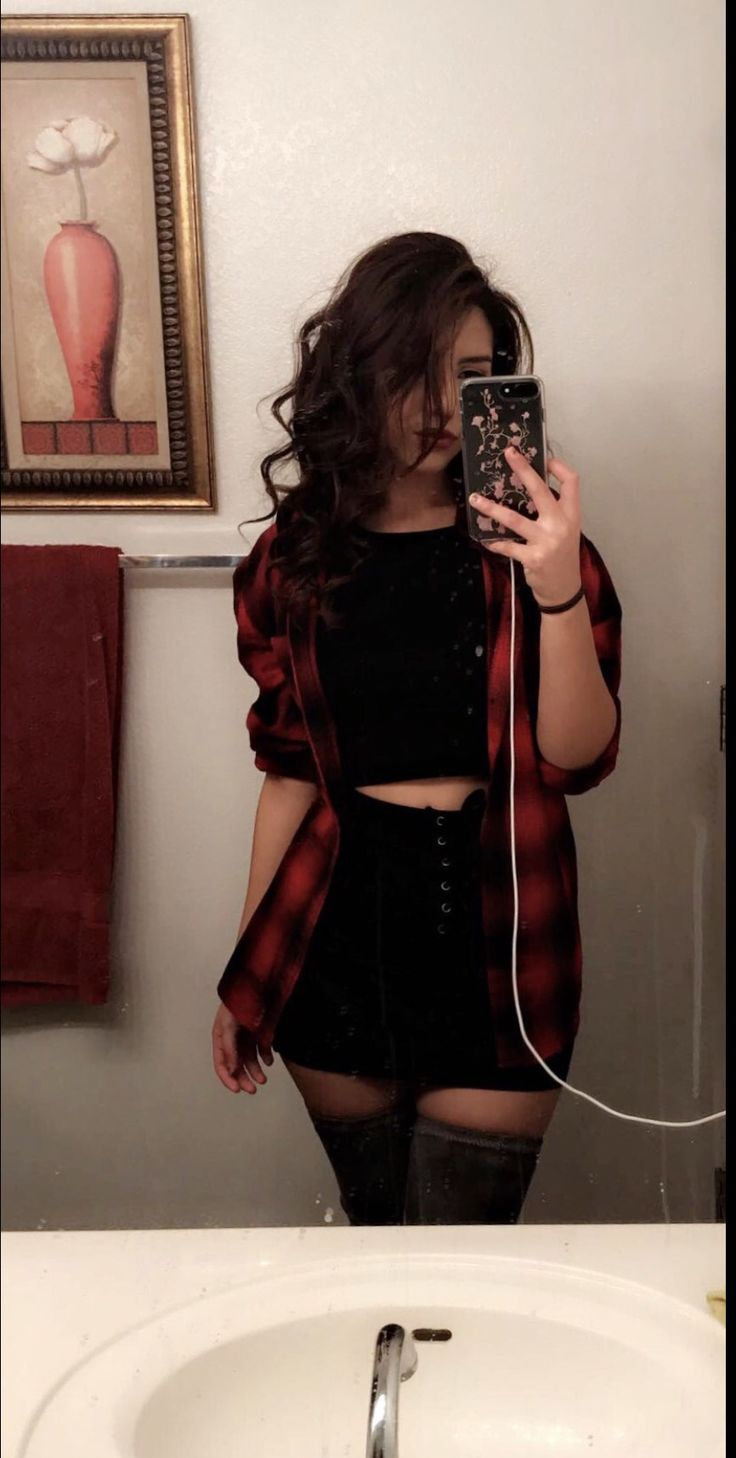 Red flannel , paired with all black skirt and crop top outfit