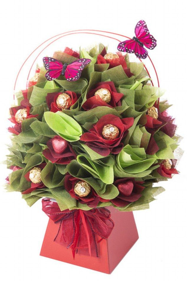 A stunning and brightly coloured tissue paper rose bouquet studded with 26 Ferrero Rocher and 12 milk chocolates