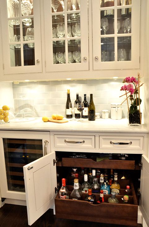 White cabinets (with glass) and backsplash. Don't really like the counter-top, though (too white)