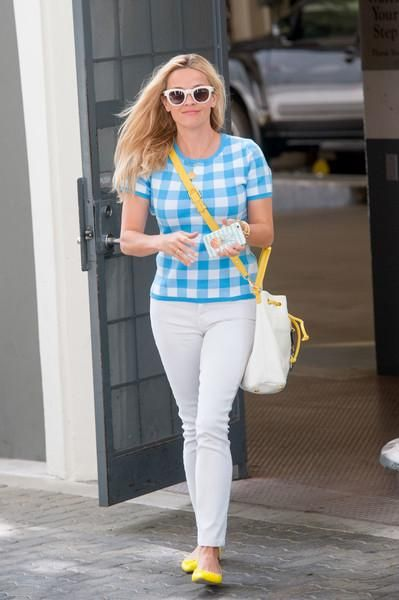 Reese Witherspoon wearing Draper James White Crop Flare Denim Jeans, Saint Laurent Sl 102 Surf Sunglasses in White, Draper James Orleans Bucket Bag and J.Crew Gemma Flats in Yellow