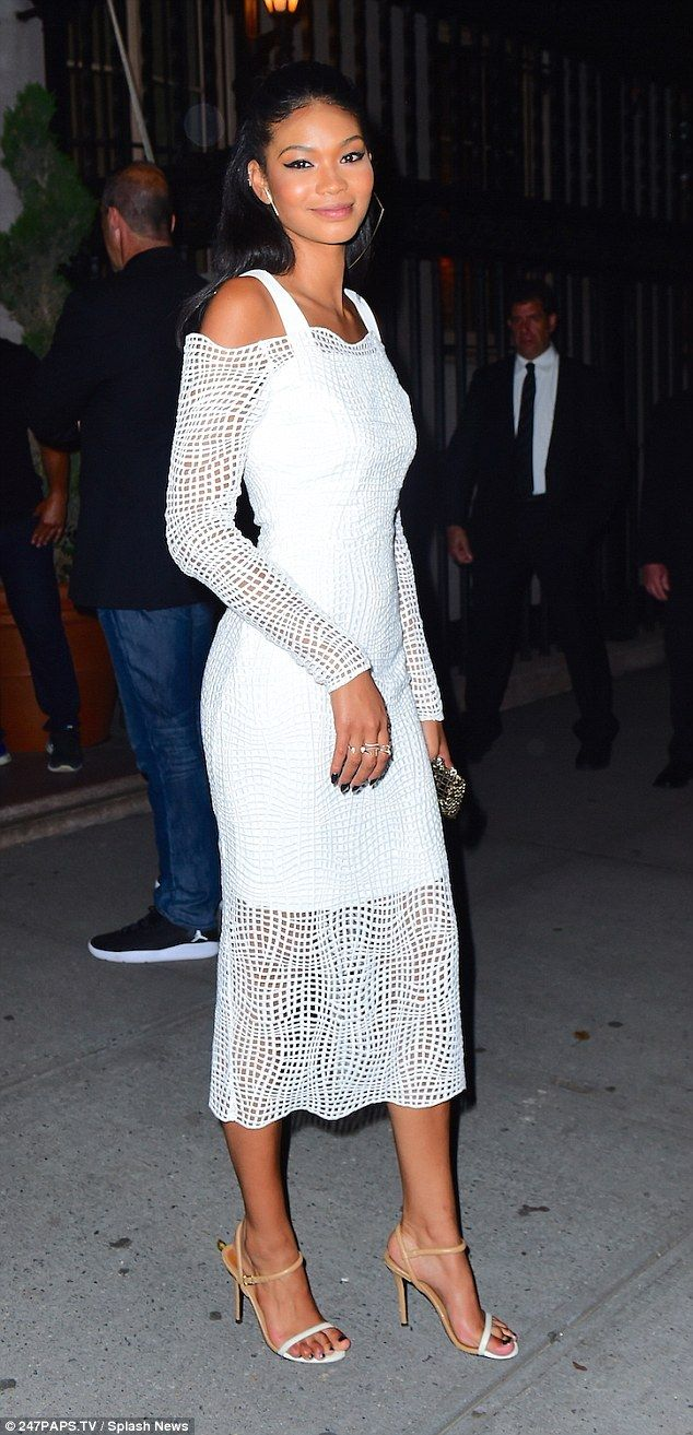 Enjoying the party! Model Chanel Iman looked stunning in a midi length white dress for the starry bash