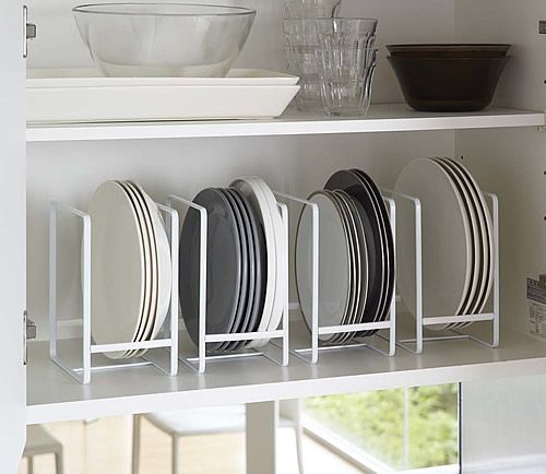 Store more plates on a shelf that is too wide and not tall enough. You've got to make the most of your space.