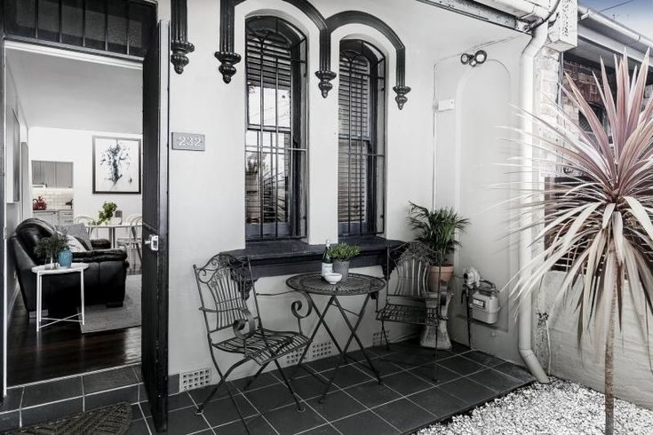 Chic designer terrace. No matter what the current style is, black and white with always exude elegance and class!