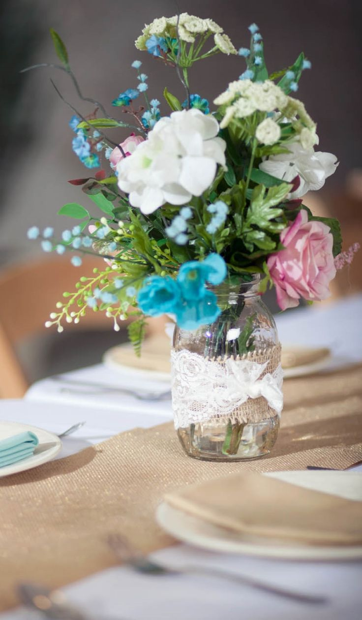pictures of wedding centerpieces using mason jars%0A Idea Market Burlap and Lace Wrapped Floral Centerpiece  Find this Pin and  more on Mason Jar Crafts with