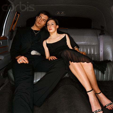 Couple in the Back Seat of Limousine