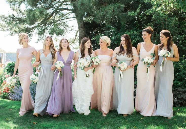 Mix and match soft pastel bridesmaids dresses. Prefect for this riverfront Cape Cod tented wedding.  Floral: Gardens by Rebecca Perry Beauty: Charlotte Phinney Photo: Rebecca Arthurs Planner: Cape Cod Celebrations
