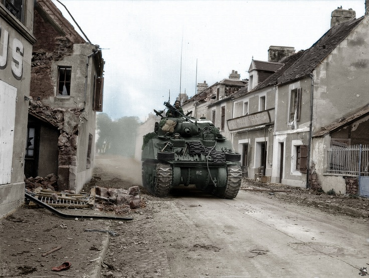 herman tank of the Canadian Sherbrooke Fusiliers advancing into Caen. 10 July 1944.