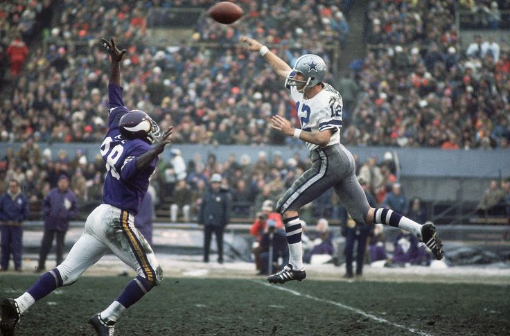 Dallas Cowboys quarterback Roger Staubach makes a leaping pass over Minnesota Vikings defensive tackle Alan Page on Oct. 18, 1970 at Metropolitan Stadium in Bloomington, Minn. Arguably the greatest Dallas Cowboy of all time, Staubach best embodies...