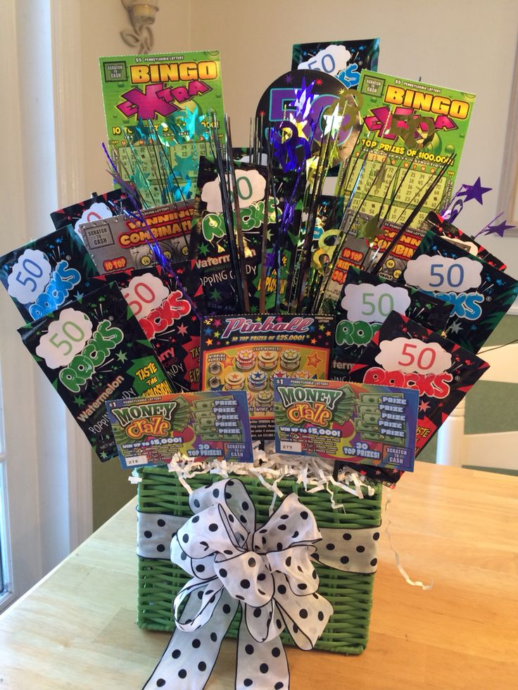 """Small basket (this one is 7""""Lx 6""""Hx 51/2"""" D). Put small """"50"""" centerpiece in basket and fill in the space around it with floral foam. Hot glue some shredded paper on top. Add packs of pop rocks with """"50"""" printed out and taped over the word pop. Lottery tickets ($20 in this bouquet...2 $5, 2 $3, 1 $2, 2 $1) Tape or hot glue tickets and candy to plant (floral)sticks and arrange them around the centerpiece. You could add photos of person or fold money into an origami shape and add bouquet"""