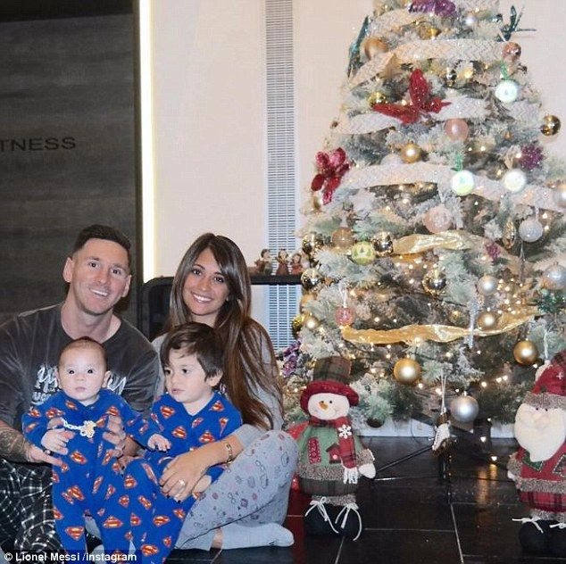 Lionel Messi poses for a Christmas photo with his long-term partnerAntonella Roccuzzo and...