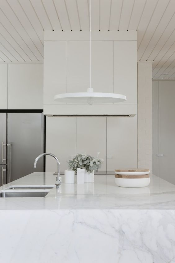 All white. Love how the fridge doors line up with cabinets above and doesn't stick out from them like a lot of kitchens do.
