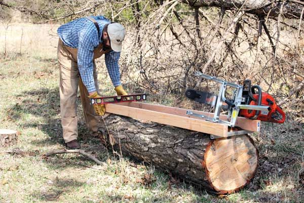 Save big by choosing an affordable, portable sawmill to cut homemade lumber with a bandsaw mill or chainsaw mill attachment. From MOTHER EARTH NEWS magazine.