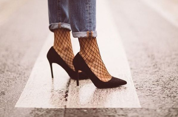 Turned up jeans with fishnets and heels! What more could a lady want...shop the look at www.calfhighs.co.uk