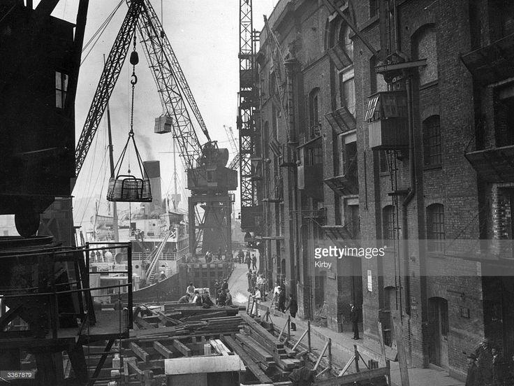 Unloading ships at Hay's Wharf, London Bridge.
