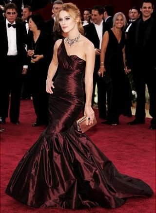 Kiera's eggplant taffeta gown was custom-made for her by Vera Wang. Her multi-colored Bulgari necklace added even more elegance to an already sophisticated look. After the Oscars, Keira donated the dress to Oxfam International for an auction which raised $7,900 for the food crisis in East Africa.