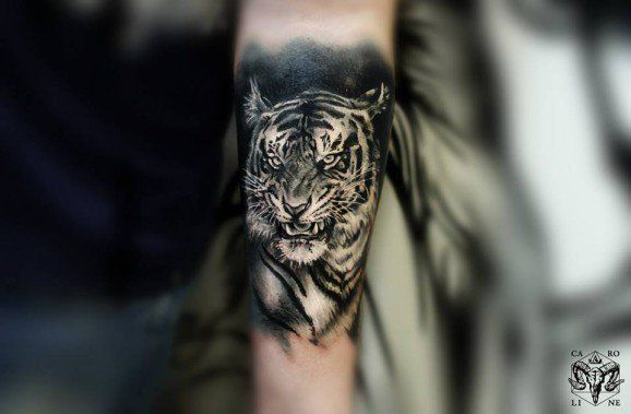 A small black and grey tattoo by Caroline Friedmann.