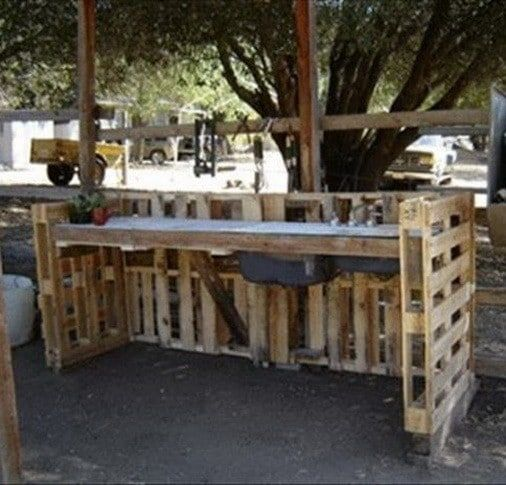 Outside work bench made from 4 recycled wooden pallets