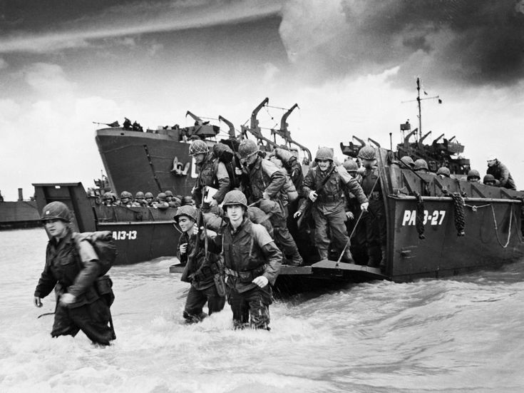 D-Day Landing 1944 by Robert Capa (this is the caption that came with this pin//the caption with the photo on the web site is: American reinforcements, arrive on the beaches of Normandy from a Coast Guard landing barge into the surf on the French coast on June 23, 1944. They will reinforce fighting units that secured the Norman beachhead and spread north toward Cherbourg.//this is NOT a Capa photo