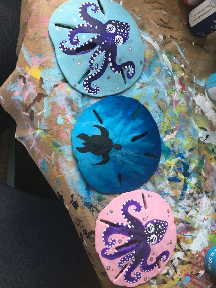 Hand painted sand dollars. Turtle and octopus