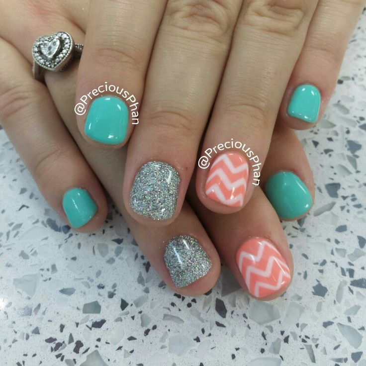 Mint and coral nails. With a white Chevron.