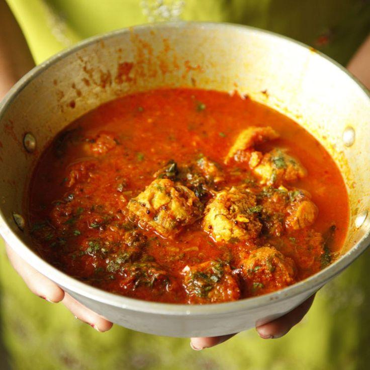 Chickpea-flour Dumplings in Spiced Tomato Sauce (Dharan Ji Kadhi) | This rich dish features chickpea-flour dumplings, a Sindhi specialty.