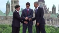 Handshake involving Canada's PM Justin Trudeau and former US President Barack Obama