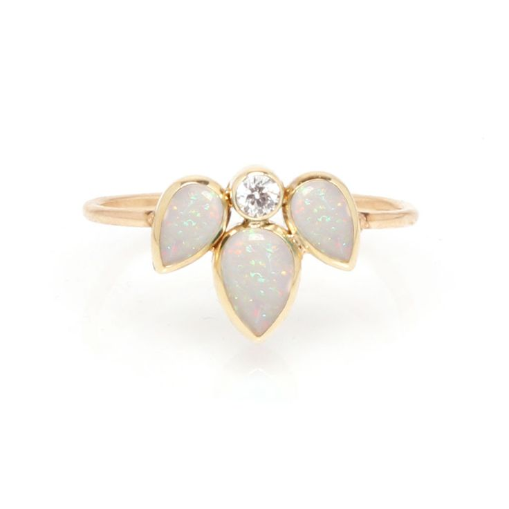 14k gold 3 tear bezel set opal ring with a 5pt diamond SPECIFICS • two small opal tears 5x3 mm each • middle opal tear 6x4 mm • white diamond .05 ctw
