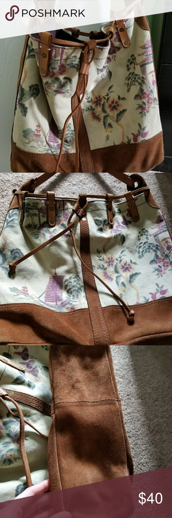 Lucky Brand Purse Used Lucky Brand Purse with cute Asian floral print. Comes from a smoke free home. I bought it used but never actually used it. Purse does have mark on back, see picture. Also suede on bottom isn't perfect, can see where it is worn on one corner. Minor marks on front. Please see all pictures for details and ask me any questions you may have. Purse still looks super cute. Make me an offer! Lucky Brand Bags Shoulder Bags