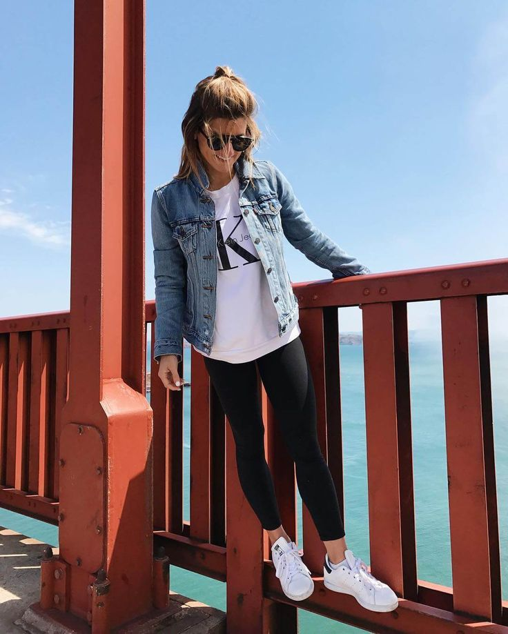 In San Francisco at the Golden Gate Bridge after a bike ride wearing leggings and sneakers
