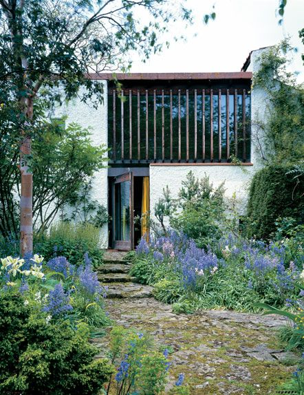 Turn End in Thame, Oxon by Peter Aldington (1960's). This pivoting door and upper window are the most dominant features on the spring garden side of the house.