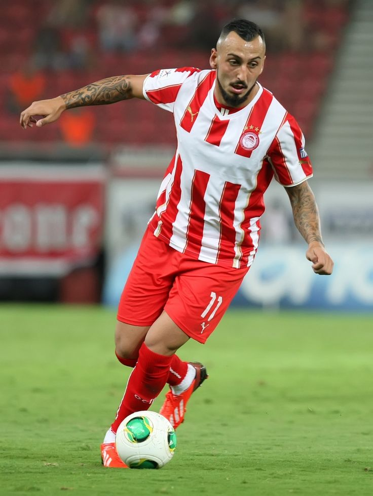 Mitroglou he has a killing shot and he is physical strong