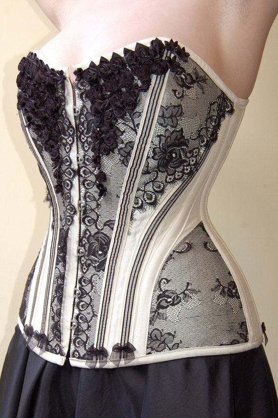 I don't know this corsetiere, but I love their use of contrasting fabrics with this pattern. White Gold Silk Corset with French Lace & Roses by kikuboutique