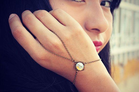rainbow crystal slave bracelet, ring bracelet, slave ring, unique bracelet, crystal ring. $23.00, via Etsy.