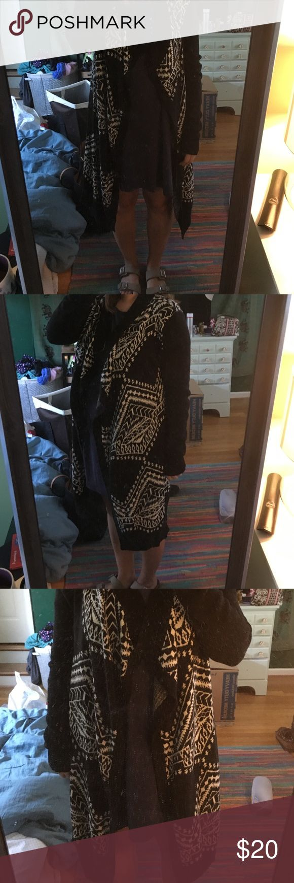 Ecote tribal print cardigan Black and cream colored sweater/cardigan from Urban Outfitters (ecote). Like new, no damage and super cute! I just don't like the way it looks on me. My trash could be your treasure! Urban Outfitters Sweaters Cardigans