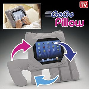 "Product # HC6438 - The most versatile pillow ever! Take it everywhere - this soft pillow is specially designed to function on any surface - wherever you are! The multi-slot design keeps any size tablet safe and secure. The dual stretch straps on the back allow the pillow to be mounted on the back of a headrest while traveling by car, or fold it into a travel pillow (15""L x 4-1/2""H x 12-3/4""W). Design allows for easy access to power cord and earpiece sockets. 12-1/2""-SQ. x 4-1/2""W."