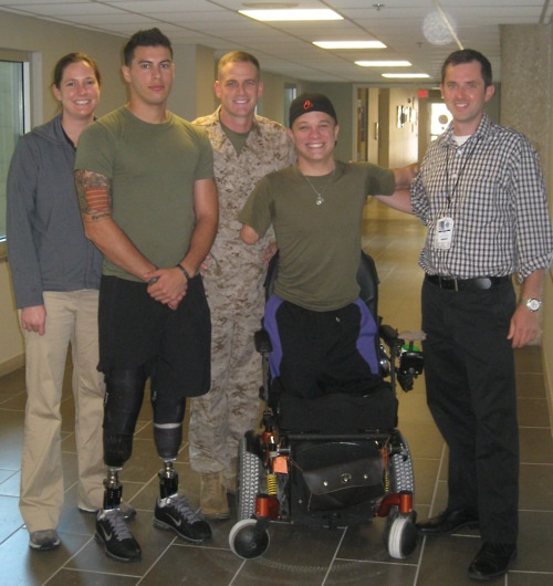 Capt. Aloysius Boyle (center) stands with Julie Castles, Lance Cpl. Matias Ferreira, Cpl. Tyler Southern and Joe Butkus outside the Military Advanced Training Center here. Boyle has been responsible for preparing the Marines at WRAMC for their upcoming move to the new Walter Reed in Bethesda, Md. which will be called Walter Reed National Military Medical Center. Castles, a physical therapist, and Butkus, an occupational therapist, work in the MATC assisting wounded, ill and injured Marines…