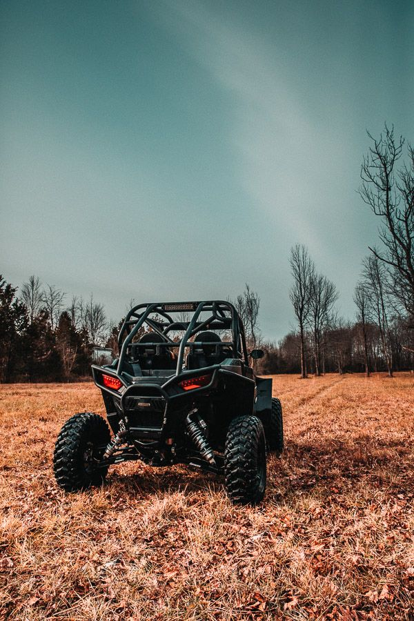 Crunching through the leaves and headed for the woods  Polaris RZR