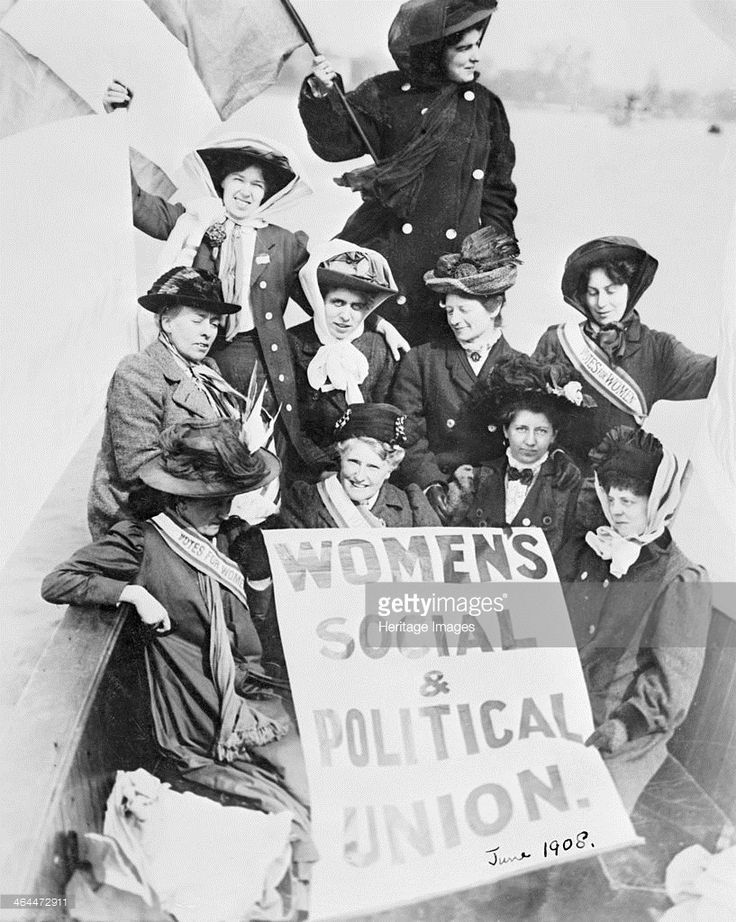 Ten suffragettes advertising the Women's Social and Political Union, from a boat on the Thames, June 1908. The women are wearing 'Votes for Women' sashes and hats held in place with 'Votes for Women' silk scarves.