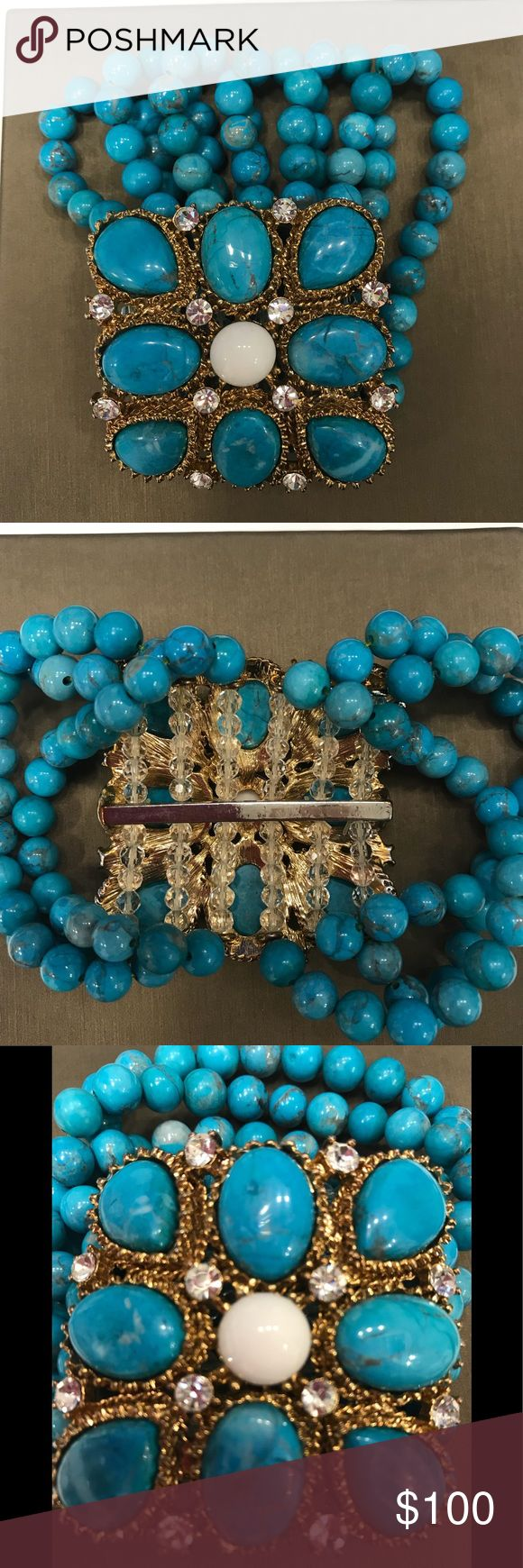 Beaded Cuff Bracelet from Neiman Marcus Never been worn turquoise colored beaded cuff bracelet. Purchased from Neiman Marcus. Stands of beads are on expandable thread to create ease in getting bracelet on and off. No missing stones or beads. Jewelry Bracelets