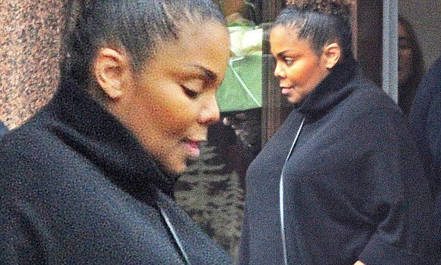 Pregnant Janet Jackson, 50, covers her bump on London outing