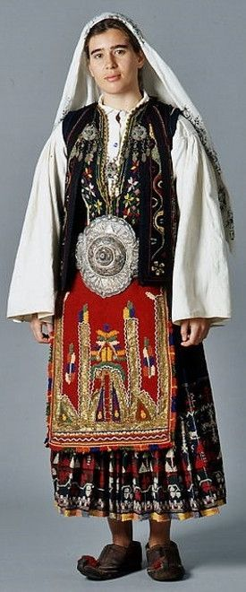 A Sarakasani (or: Karakatsani) woman in traditional festive outfit.  From northern Greece.  Clothing style: ca. 1925-1950.  The Sarakatsani are an ethnic Greek population group,  who were traditionally transhumant shepherds, native to Greece, with smaller presence in neighbouring Bulgaria, southern Albania and the Republic of Macedonia.