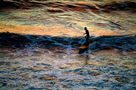 Surfing in the sunset  Photo by Andrea Gattini -- National Geographic Your Shot